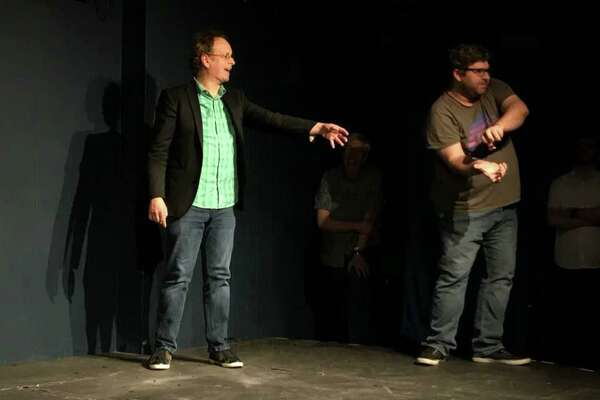 Comedian Kevin McDonald (left) on stage at Station Theater