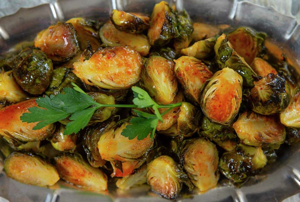 Roasted Brussels sprouts sport a flavorful kimchee vinaigrette.