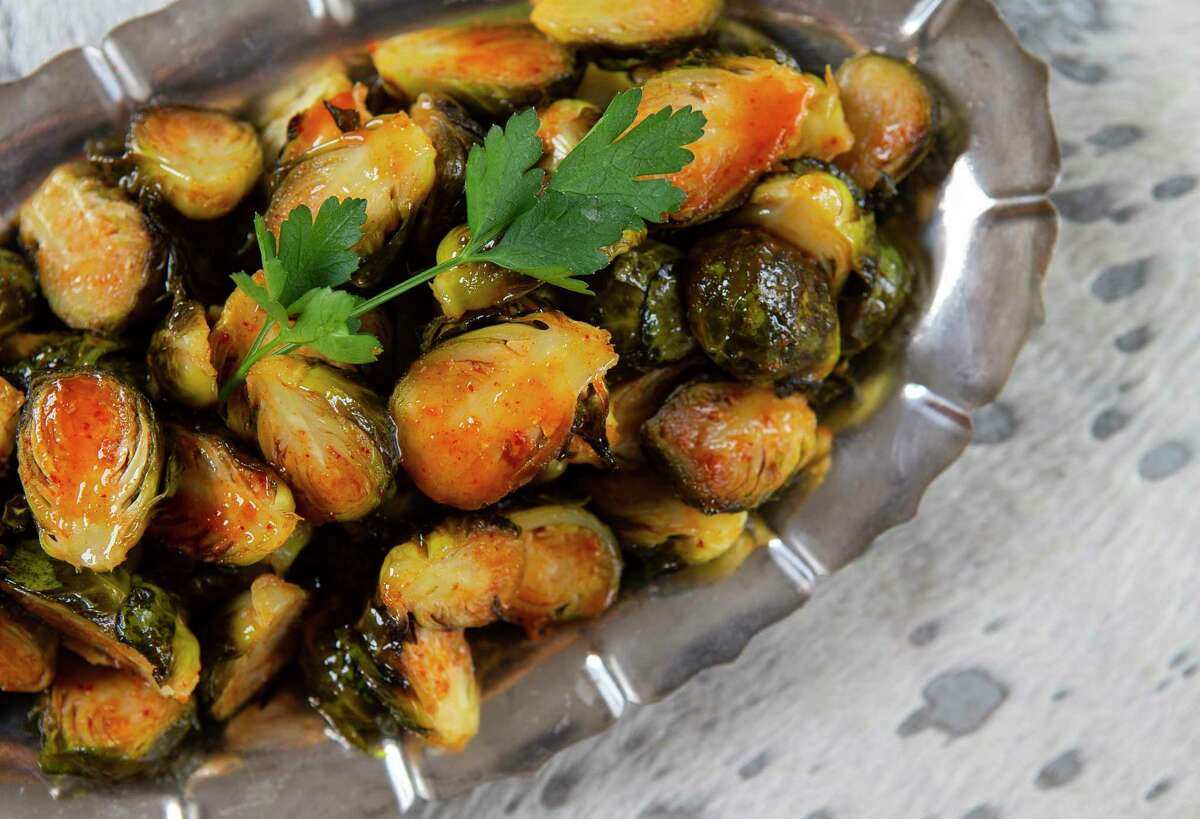 Roasted Brussels sprouts sport a flavorful kimchi vinaigrette.