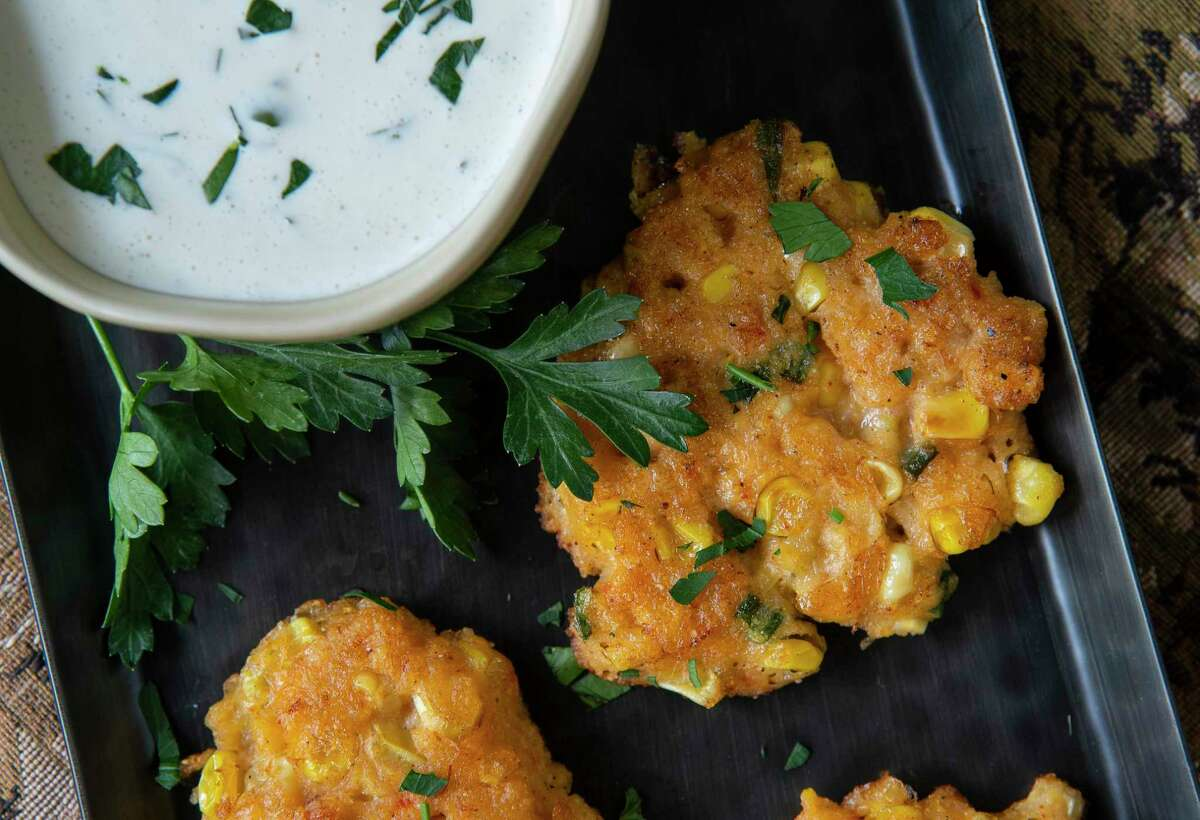 Crispy corn and crawfish fritters are served with jalapeño ranch.
