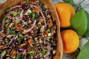 Wild rice salad with cranberries and toasted pecans is dressed with a satsuma vinaigrette.