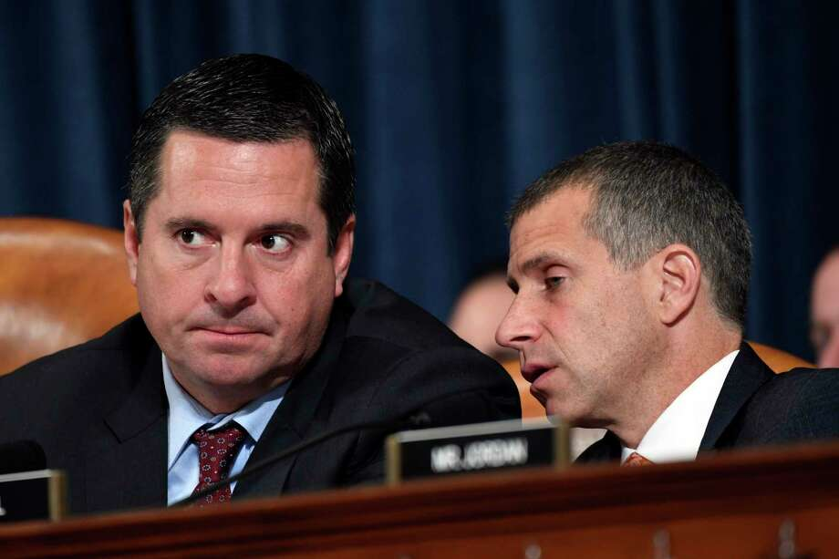 Ranking member Rep. Devin Nunes, R-Calif., left, talks to Steve Castor, Republican staff attorney for the House Oversight Committee, during testimony from former U.S. Ambassador to Ukraine Marie Yovanovitch at the House Intelligence Committee on Capitol Hill in Washington Nov. 15 in the second public impeachment hearing of President Donald Trump's efforts to tie U.S. aid for Ukraine to investigations of his political opponents. Photo: Susan Walsh / Associated Press / Copyright 2019 The Associated Press. All rights reserved.