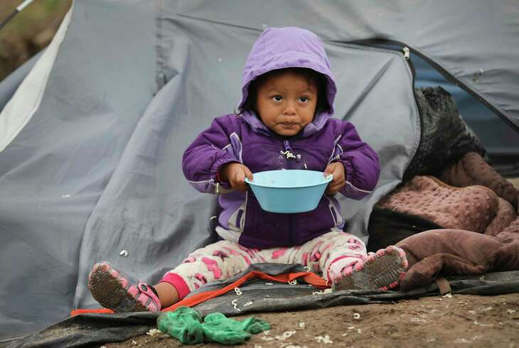 Sarai Balansar Mendez, 2-year-old from Guerrero, MX, eats a meal of noodles at her family's tent in the refugee camp for asylum seekers in Matamoros on Wednesday, Nov. 13, 2019.