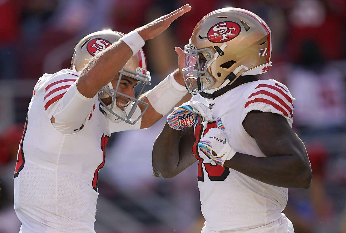SANTA CLARA, CALIFORNIA - OCTOBER 27: Deebo Samuel #19 and Jimmy Garoppolo #10 of the San Francisco 49ers celebrates after Samuel scored a touchdown against the Carolina Panthers during the third quarter of an NFL football game at Levi's Stadium on October 27, 2019 in Santa Clara, California. (Photo by Thearon W. Henderson/Getty Images)