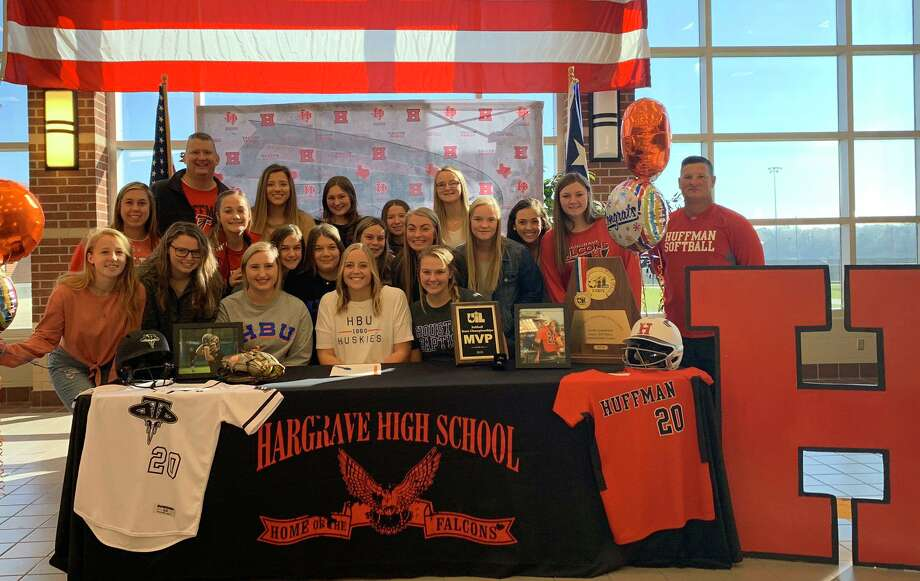 Katy Janes's Hargrave softball teammates and coaches gather around her after she signed her National Letter of Intent at a ceremony at Hargrave High School on Nov. 15 officially committing to play softball at Houston Baptist University Photo: Courtesy Photo, Hargrave Softball