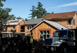 A large home at 336 Walsh Road is seen under construction in Atherton, Calif. Thursday, July 25, 2019.