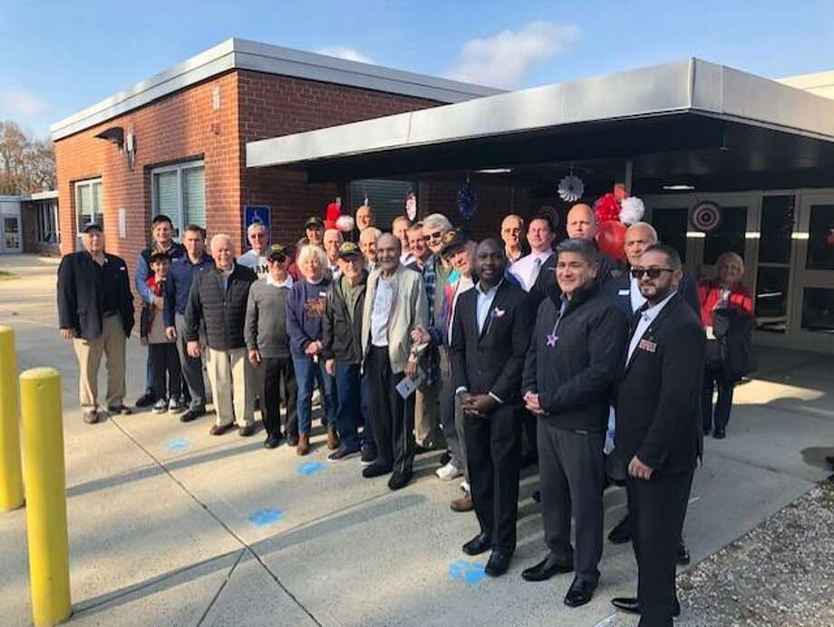 On Monday, Nov. 11, the fourth grade class at Booth Hill Elementary School welcomed and celebrated veterans in their inaugural Veteran's Day celebration. Photo: Contributed Photos