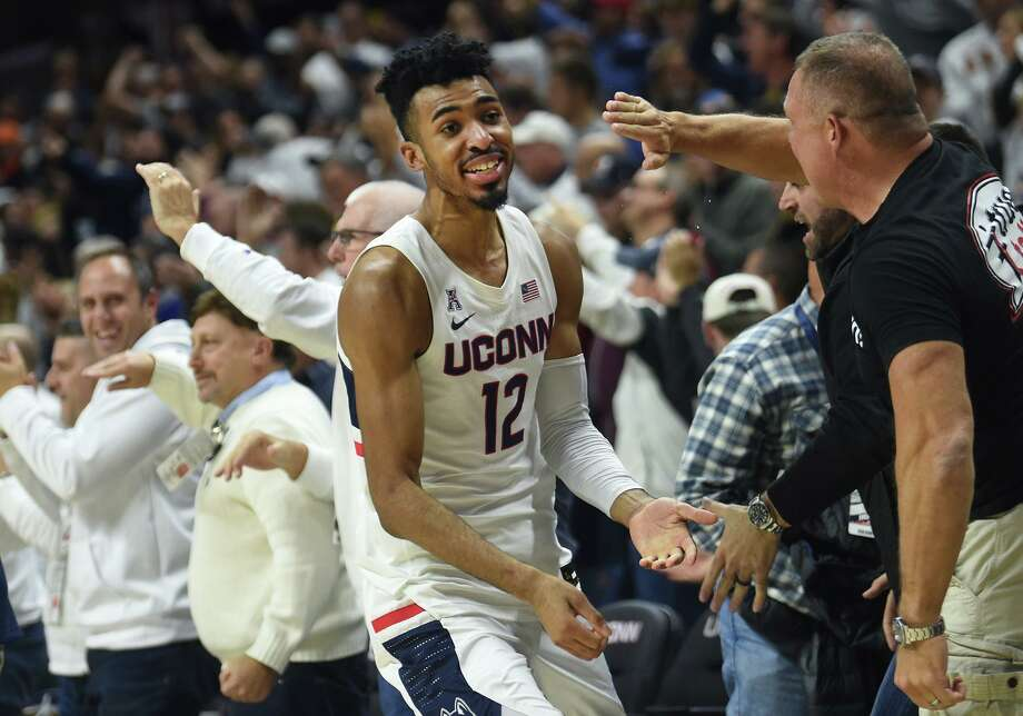 Connecticut Huskies forward Tyler Polley (12) celebrates with fans during a game against the Florida Gators on Sunday, Nov. 17, 2019 at Gampel Pavilion in Storrs, Conn. UConn won the game 62-59. (Brad Horrigan/Hartford Courant/TNS) Photo: Brad Horrigan / TNS / Hartford Courant