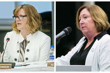 Julie Johnson, left, and Monica Bristow, right, speak at a recent Lewis and Clark Community College meeting.