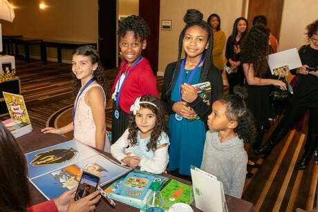 Published student authors   at the 10th annual iWrite Literacy Organization luncheon and book signing