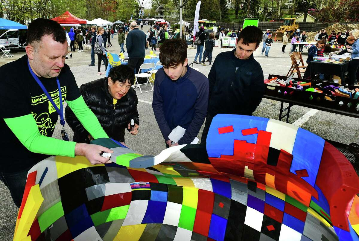 Greens Farms Academy Director of Technology Jesse Robinson gets help from Sunrise Rotarian Sheila Keenan and visitors Jonah Halperin and Niels Bantitbergenas to assemble The Great Duck Project, sponsored by Westport Sunrise Rotary Club, during the 8th annual Maker Faire Westport this past April. The 9th annual edition has been renamed Maker Faire Connecticut to reflect its growing size and impact, and will take place next year over two days - Saturday and Sunday, April 18 and 19, 2020 - at Staples High School in Westport.
