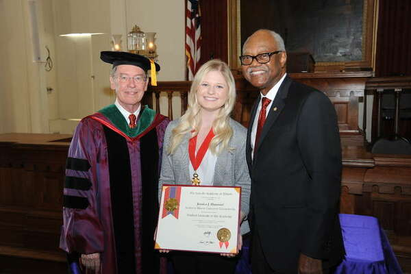 SIUE student Jessica Hammel receives her Student Laureate Award Saturday. She is pictured with SIU Interim President Kevin Dorsey, left, and Lincoln Academy Chancellor Frank Clark.