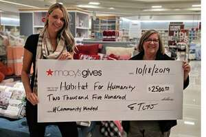 Erin Tito, Store Manager, Macys Danbury presents a check to Fran Normann, executive director at Housatonic Habitat for Humanity.