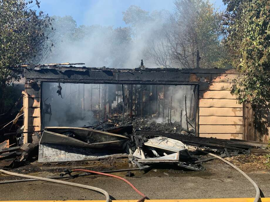 San Antonio Fire is battling a blaze that spread to two houses in a North Side neighborhood. Photo: Taylor Pettaway/ San Antonio Express-News