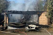 San Antonio Fire is battling a blaze that spread to two houses in a North Side neighborhood.