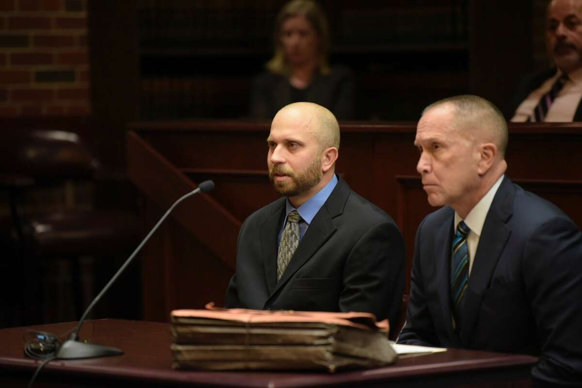 Eric Rosenbrock , left, and his attorney, David Taffany, sit in court Monday as Saratoga County Judge James A. Murphy II prepared to sentence Rosenbrock to five years probation Monday in the accidental shooting of his wife last year.