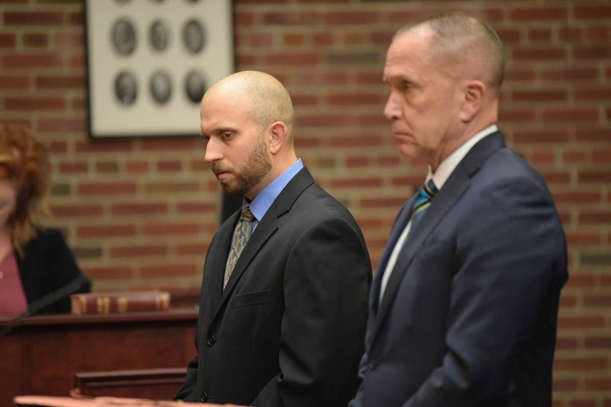 Eric Rosenbrock , left, and his attorney, David Taffany, stand in court Monday as Saratoga County Judge James A. Murphy II prepared to sentence Rosenbrock to five years probation Monday in the accidental shooting of his wife last year.