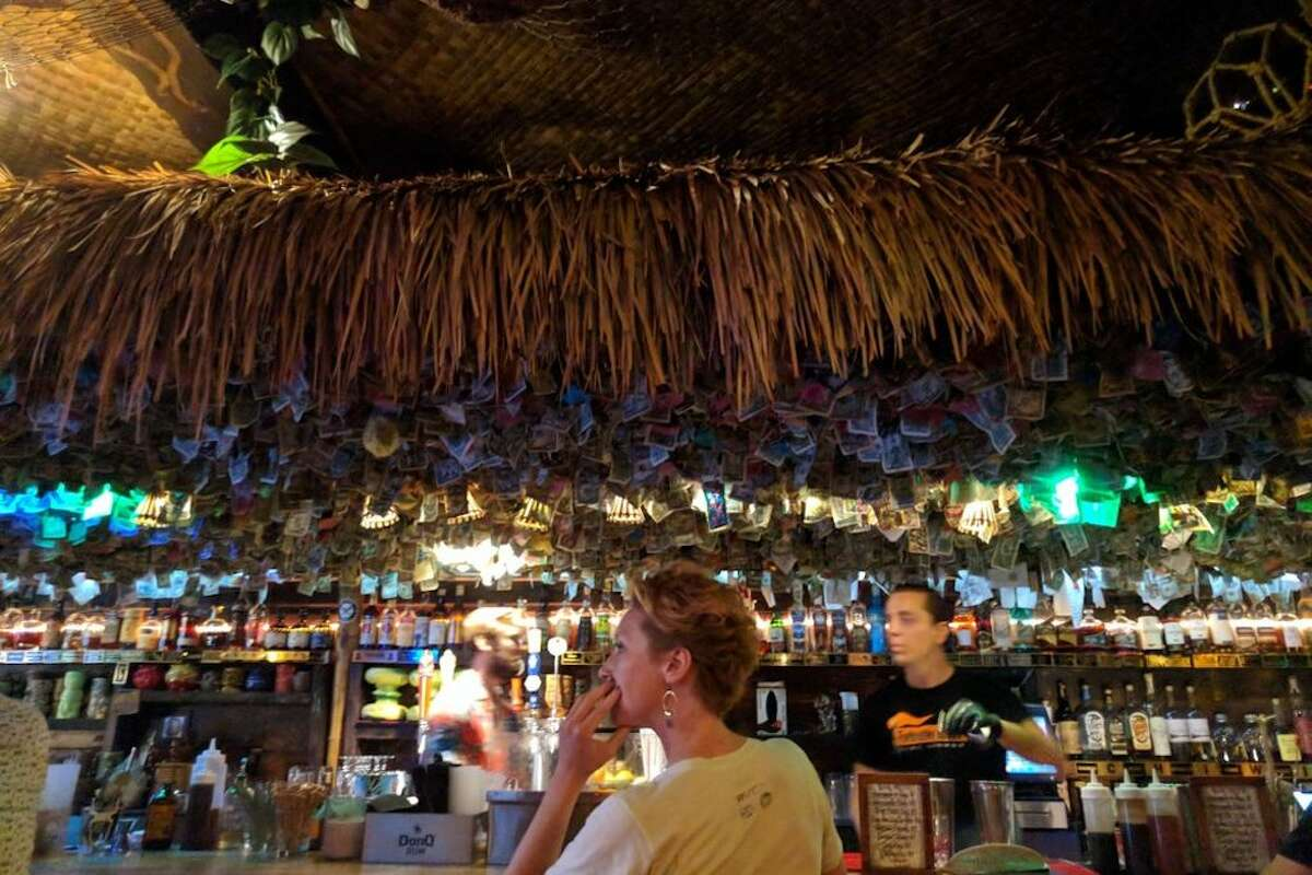 Thousands of dollars were tacked on the ceiling and walls of tiki bar Forbidden Island in Alameda.