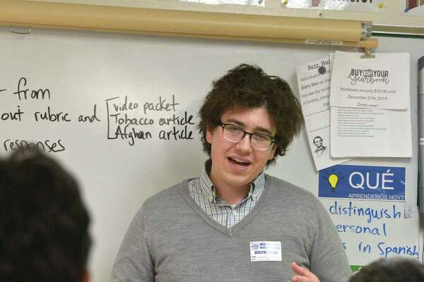 Liam Enea, a Brookfield High School senior, has started an after-school club where he teaches middle school students about economics. This is the programs second year. Tuesday, November 12, 2019, at Whisconier Middle School, Brookfield, Conn.
