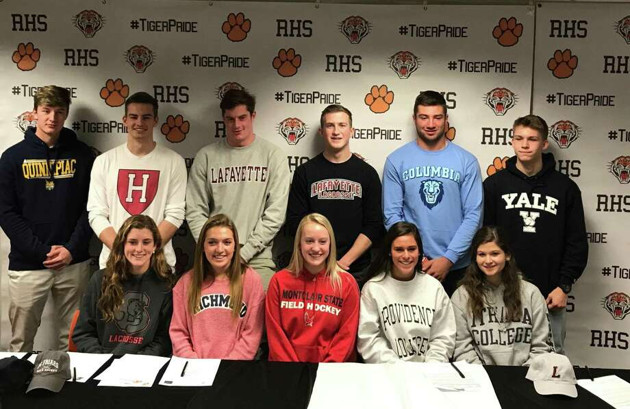 Eleven Ridgefield High seniors who will play college sports signed ceremonial letters of intent last Thursday at the school. Front row (left to right): Caitlin Slaminko (Cornell women's lacrosse), Tess Pisanelli (Richmond track and field/cross country), Bailey Harriott (MontclairState field hockey), Bella Carrozza (Providence field hockey), Lexi Held (Ithaca women's lacrosse); back row: Matt DeLuca (Quinnipiac baseball), Ray Dearth (Harvard men's lacrosse), Jack Dowd (Lafayette men's lacrosse), John Mathes (Lafayette men's lacrosse), Reid Englert (Columbia football), Simon Jupp (Yale men's track and field). Photo: Contributed Photo / Ridgefield High Athletic Department
