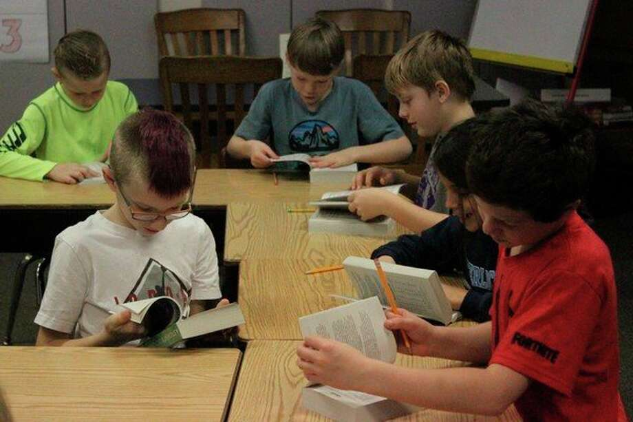 Third grade students excitedly explored their new dictionaries for about 20 minutes after receiving them, prior to resuming their regular academic activities. (Photo/Robert Myers)
