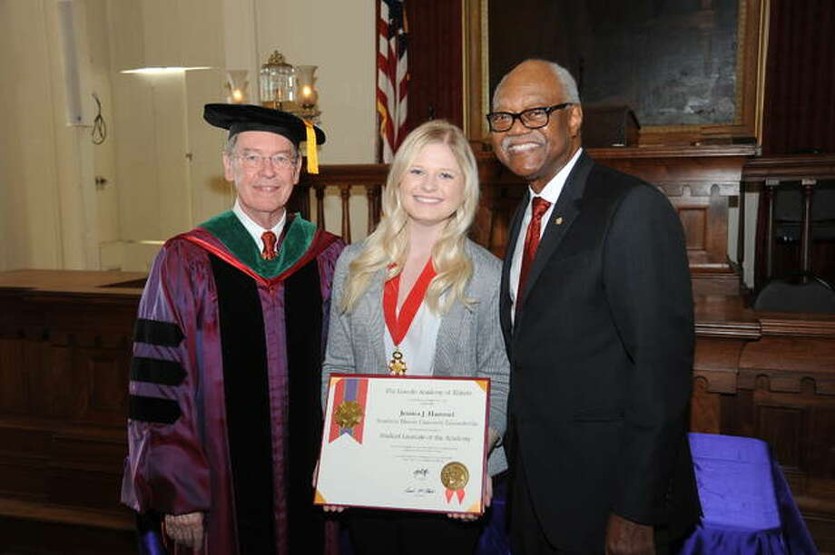 SIUE student Jessica Hammel receives her Student Laureate Award Saturday. She is pictured with SIU Interim President Kevin Dorsey, left, and Lincoln Academy Chancellor Frank Clark. Photo: David Blanchette|For The Intelligencer
