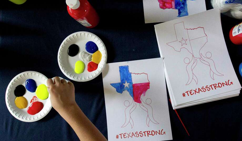 Children decorate art pieces with the hashtag #TexasStrong as hundreds of residents affected by Hurricane Harvey were provided a free meal at Sam K. Hailey Elementary School, Wednesday, Aug. 30, 2017, in Spring. The new Ready Rosie toolkit doesn't just prepare kids for a coming storm, it also gives parents tools to talk to their kids after the storm. Photo: Jason Fochtman, Staff Photographer / Houston Chronicle / Internal