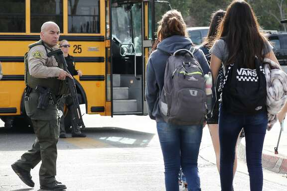 SANTA CLARITA, CALIFORNIA - NOVEMBER 14: Students are evacuated from Saugus High School onto a school bus after a shooting at the school left two students dead and three wounded on November 14, 2019 in Santa Clarita, California. A suspect in the shooting is being treated at a local hospital for a gunshot wound to the head. (Photo by Mario Tama/Getty Images)