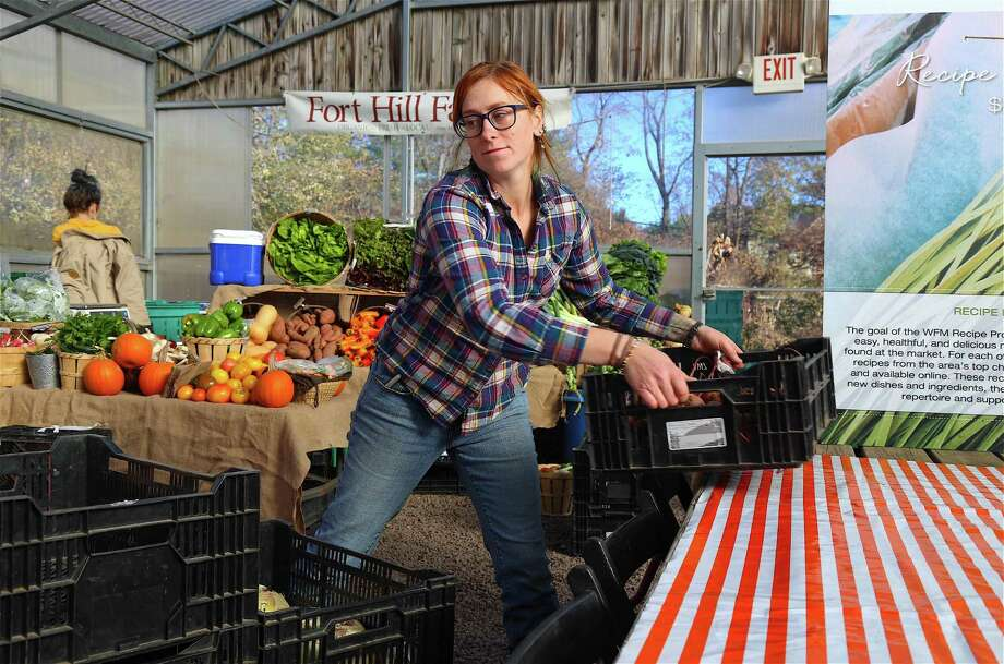 Lauren Henderson, harvest manager for Fort Hill Farm of New Milford, totes some crates at the Westport Farmer's Market on Saturday, Nov. 16, 2019, in Westport, Conn. Photo: Jarret Liotta / Jarret Liotta / ©Jarret Liotta