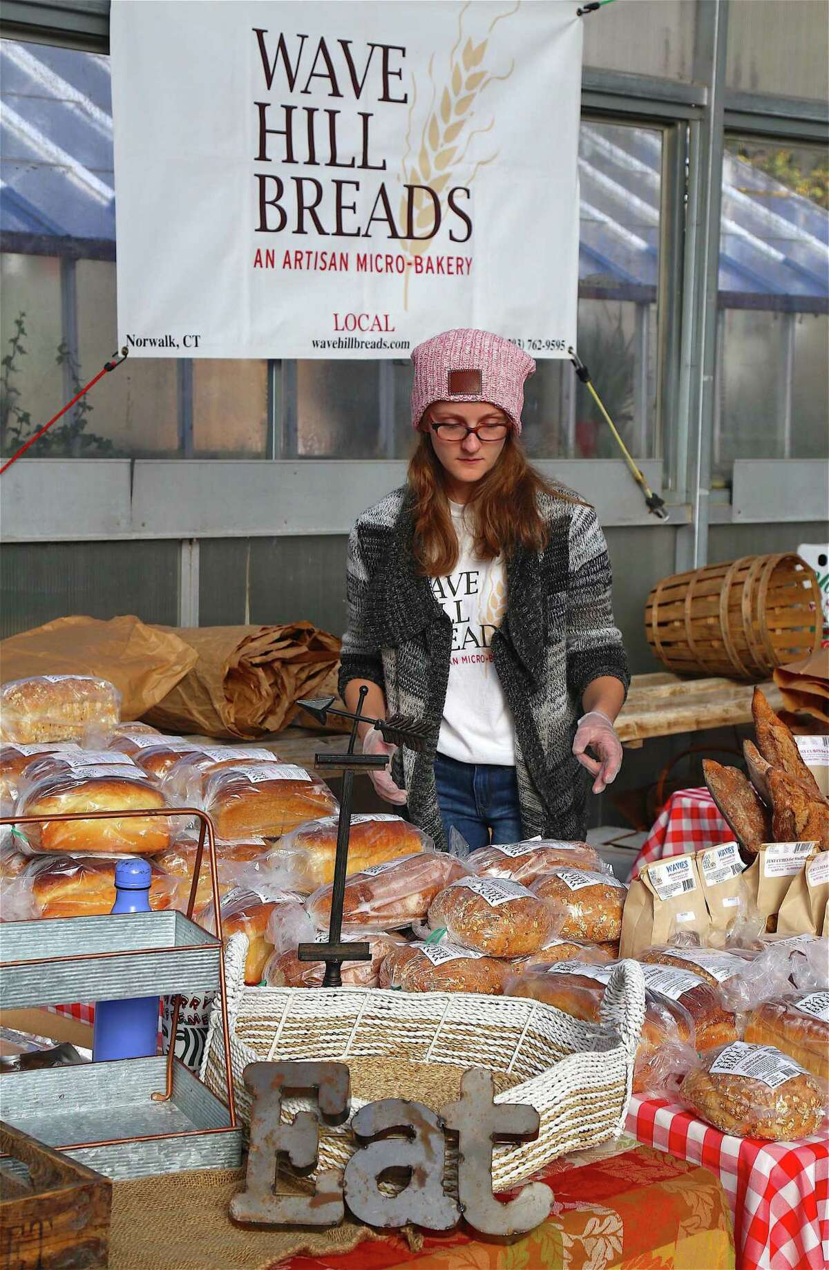 Erica Peters of Wave Hill Breads of Norwalk prepares the products at the Westport Farmer's Market on Saturday, Nov. 16, 2019, in Westport, Conn.