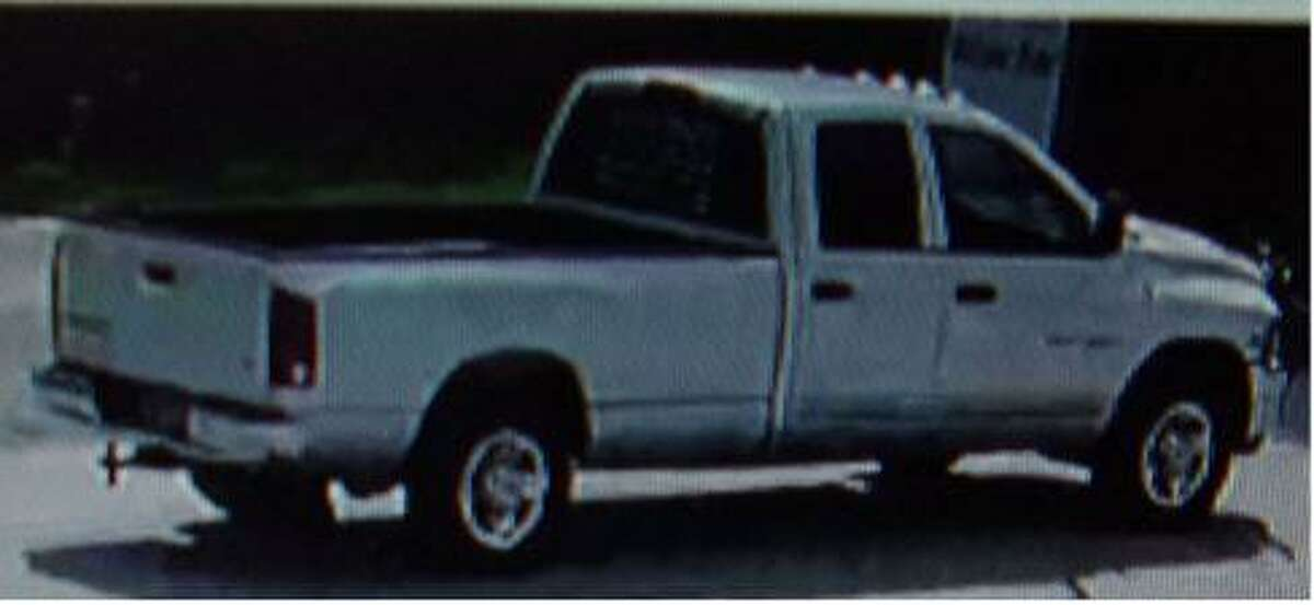 A Dodge Ram is seen in surveillance video where authorities say an all-terrain vehicle was stolen off the Conroe property.