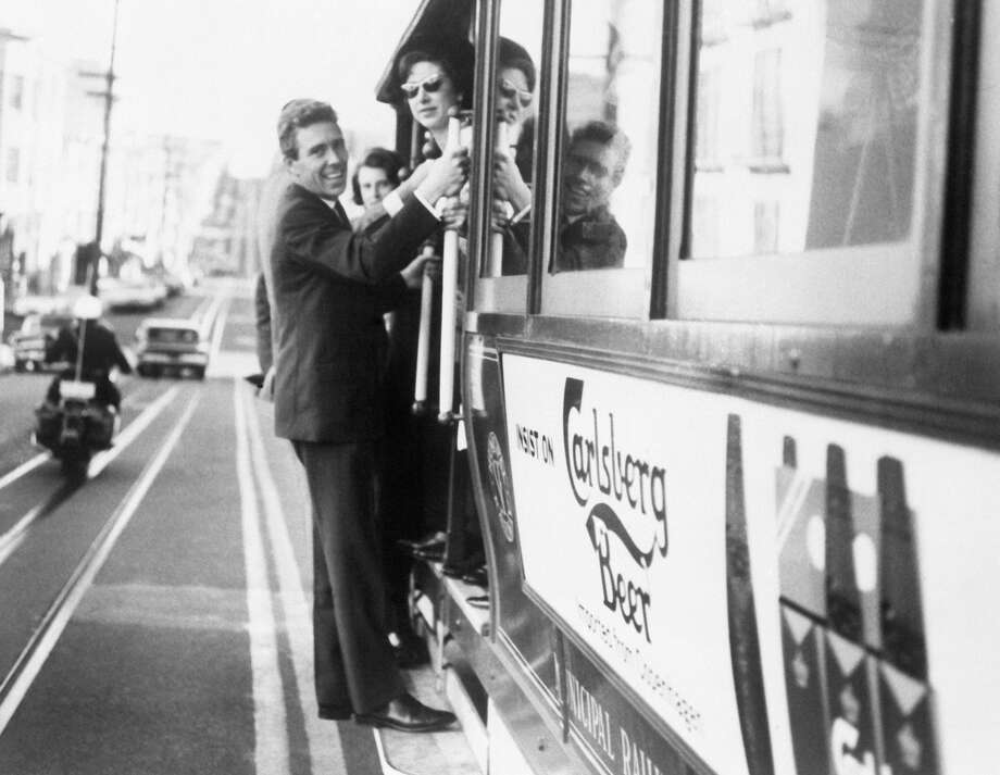 Princess Margaret and Lord Snowdon ride a cable car in San Francisco during their American tour in Nov. 1965. Photo: Keystone-France/Gamma-Keystone Via Getty Images