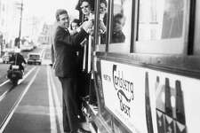 Princess Margaret and Lord Snowdon ride a cable car in San Francisco during their American tour in Nov. 1965.