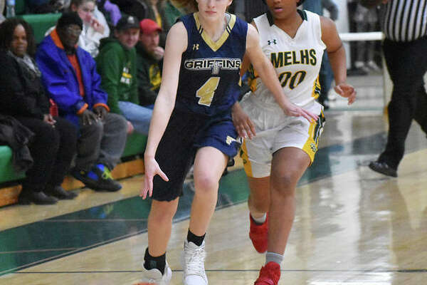 FMCHS shooting guard Anna McKee races the ball down the court during a game last season.