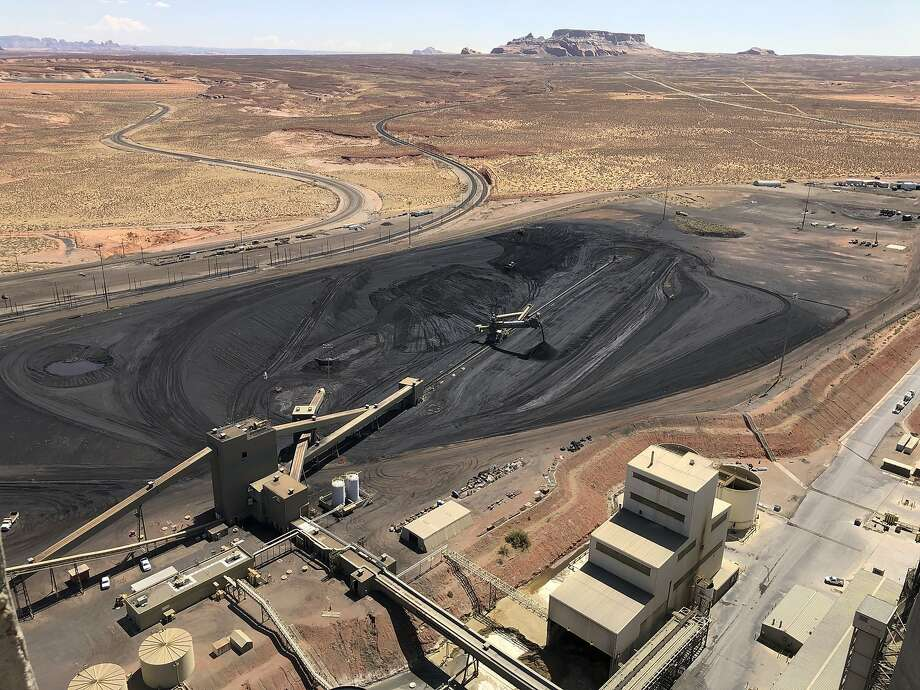 The coal stockpile at the Navajo Generating Station near Page, Ariz., is seen in August. The plant, long criticized by environmentalists, closed Monday after operating for nearly 50 years. Photo: Susan Montoya Bryan / Associated Press