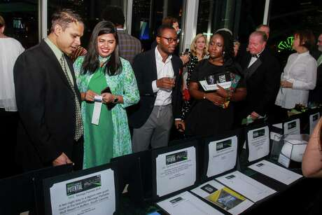 """EMBARGOED FOR SOCIETY REPORTER UNTIL NOV. 20 The silent auction at The Big Brothers Big Sisters """"An Evening for Potential"""" on November 16, 2019."""