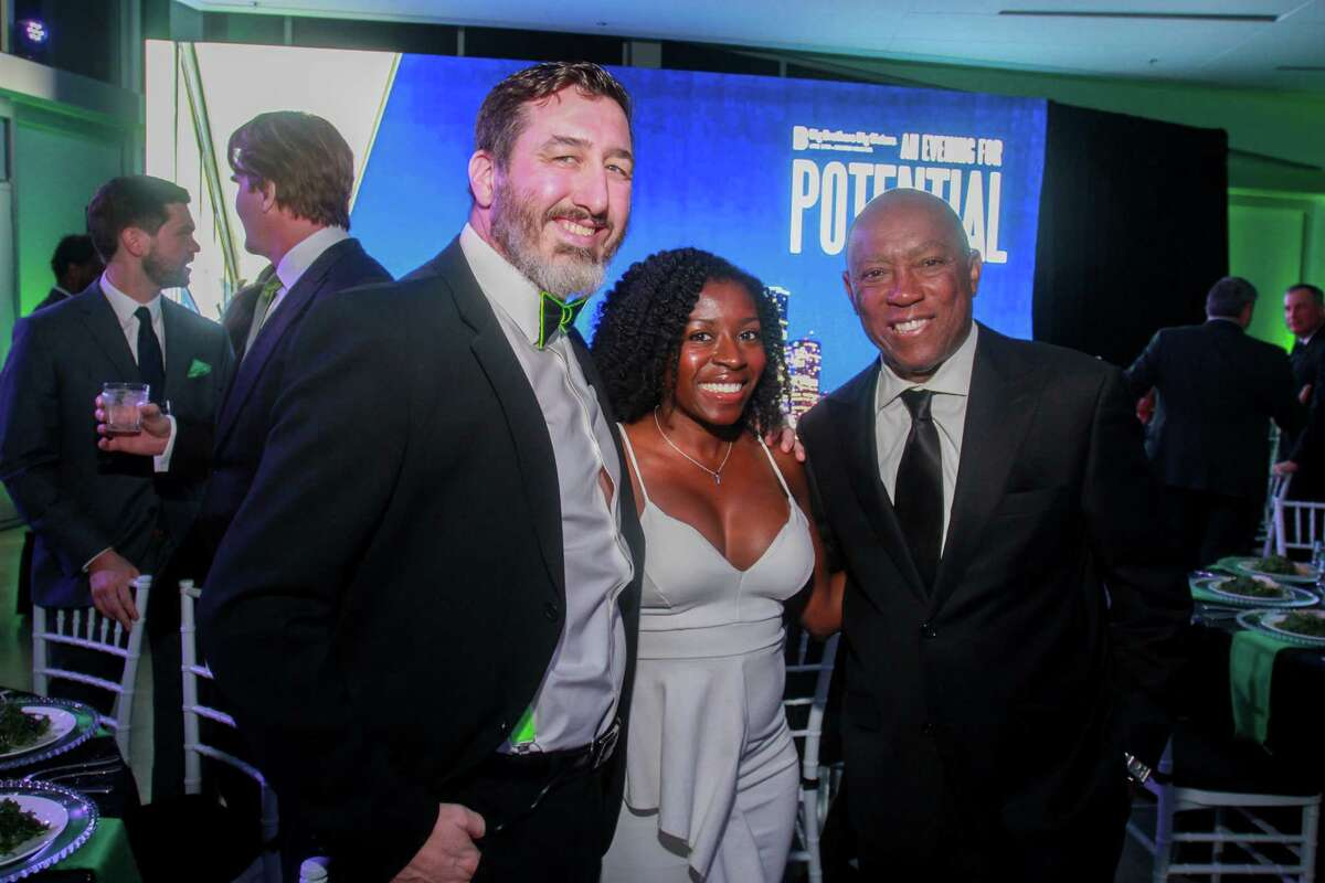 Jeremy and Maria Riegel, from left, with Mayor Sylvester Turner at The Big Brothers Big Sisters
