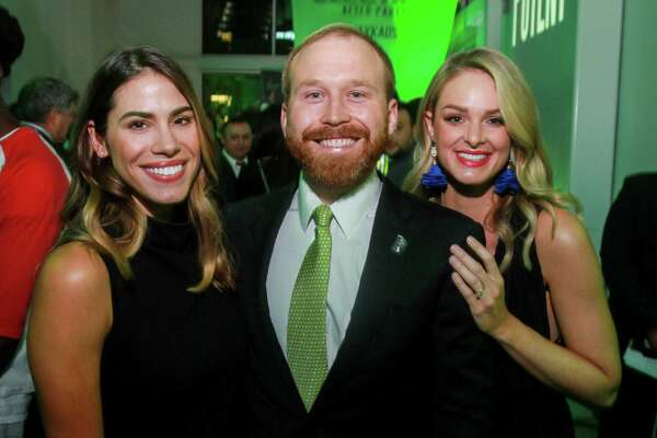 """EMBARGOED FOR SOCIETY REPORTER UNTIL NOV. 20 Stephanie McClendon, from left, with Pierce and Sarahbeth Bush at The Big Brothers Big Sisters """"An Evening for Potential"""" on November 16, 2019."""