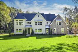 The newly constructed colonial house at 11 Little Fox Lane features 14 rooms and 7,325 square feet of living space on four finished levels.