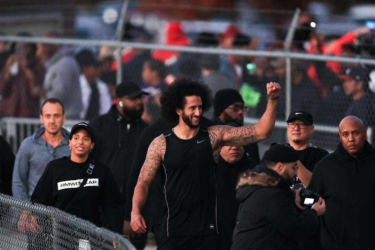 Colin Kaepernick visits with fans following his NFL workout held at Charles R. Drew High School on Saturday, Nov. 16, 2019 in Riverdale, Ga. (Carmen Mandato/Getty Images/TNS)