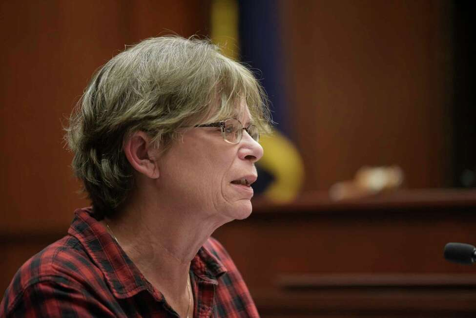 Deb Fleming delivers her victim's impact statement during the sentencing of Sherrie Burton on Monday, Nov. 18, 2019, in Ballston Spa, N.Y. Burton was sentenced for stealing more than $1 million from customers who wanted to buy a home from her company. (Paul Buckowski/Times Union)