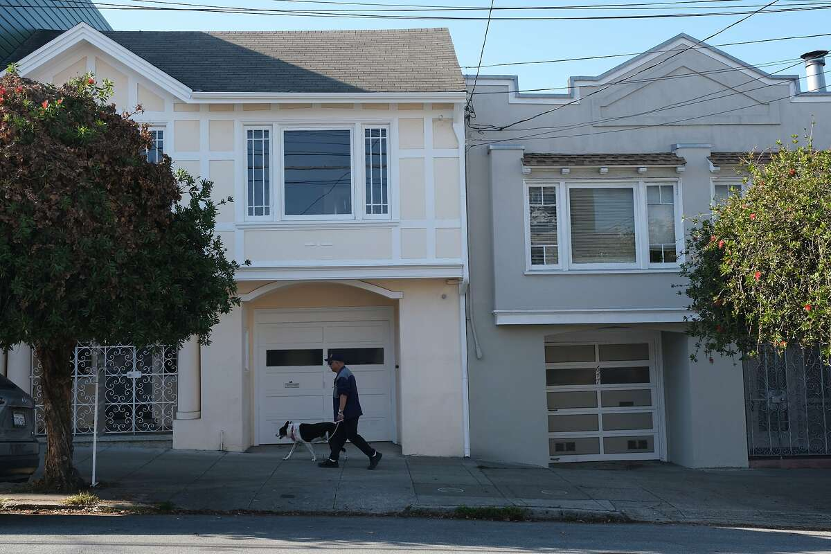 Someone walks past the property at 651 19th Avenue in San Francisco, Calif. on Monday November 18, 2019.
