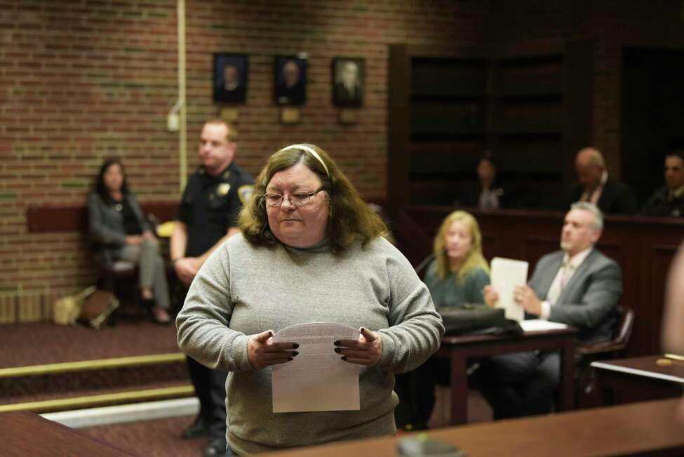 Cynthia Perkins walks up to deliver her victim's impact statement during the sentencing of Sherrie Burton on Monday, Nov. 18, 2019, in Ballston Spa, N.Y. Burton was sentenced for stealing more than $1 million from customers who wanted to buy a home from her company. (Paul Buckowski/Times Union)