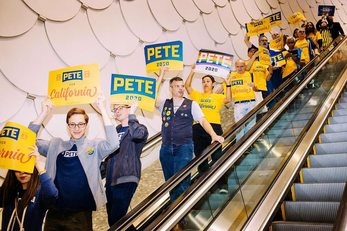 LONG BEACH, CA - NOVEMBER 16: Pete Buttigieg supporters head down an escalator during the California Democratic Party's 2019 Fall Endorsing Convention at the Long Beach Convention Center in Long Beach, California November 16, 2019.
