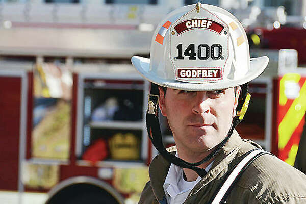Godfrey Fire Protection District Chief Erik Kambarian will be stepping down to take a new job Dec. 1. He will continue as a volunteer with the department, which he has headed since 2014.