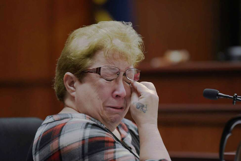 Nancy Rivett wipes tears away as she tries to give her victim's impact statement during the sentencing of Sherrie Burton on Monday, Nov. 18, 2019, in Ballston Spa, N.Y. Burton was sentenced for stealing more than $1 million from customers who wanted to buy a home from her company. (Paul Buckowski/Times Union)