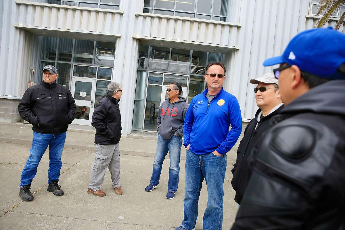 Paul Swiatko (l to r), Richard Tong, Mel Bautista, Mark Madsen, Victor Tsang, and Lewis Fong, who were all part of the special operations group San Francisco Police Department, talk outside of Building 606 at Hunters Point Shipyard on Tuesday, May 22, 2018 in San Francisco, Calif.