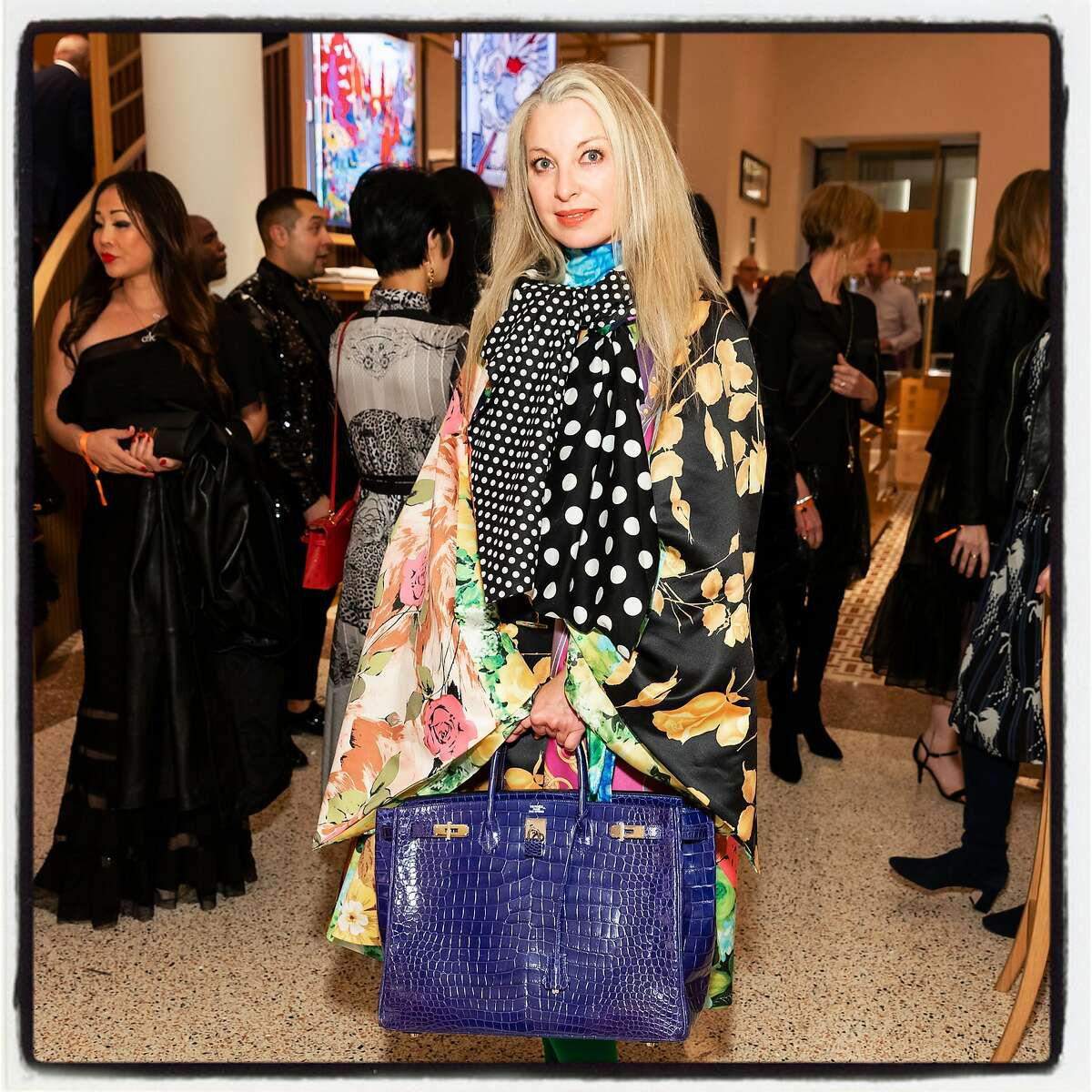 Sonya Molodetskaya with a big Hermes Birkin at the reopening on Nov. 14, 2019.