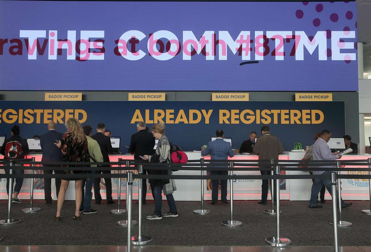 Attendees pick up their badges for the 2019 Realtors Conference & Expo at Moscone Center south on Thursday, Nov. 7, 2019, in San Francisco, Calif.