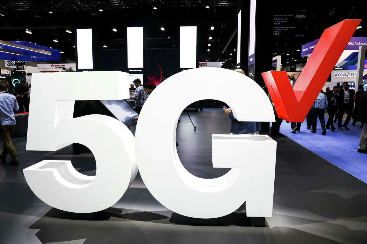 Verizon Communications Inc. 5G wireless signage is displayed at the company's booth during the Mobile World Congress Americas event in Los Angeles, California, U.S., on Tuesday, Oct. 22, 2019. The conference features prominent executives representing mobile operators, device manufacturers, technology providers, vendors and content owners from across the world. Photographer: Patrick T. Fallon/Bloomberg
